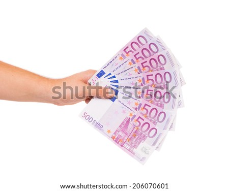 Man hand holding five hundred euro bills. Isolated on a white background. - stock photo