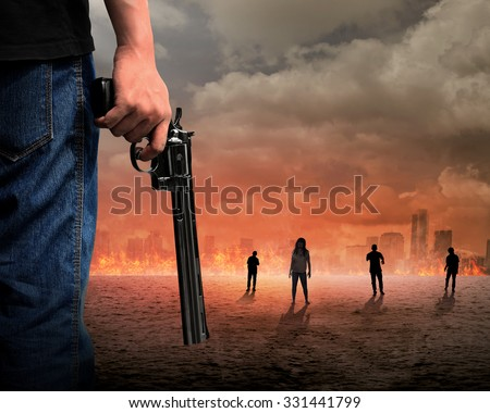 Man hand holding gun with zombie and burn city background - stock photo