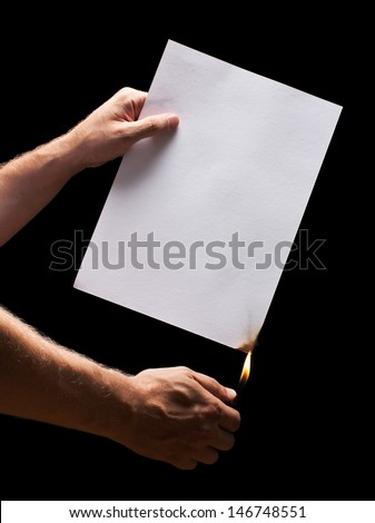 Man hand holding lighter and white burned paper