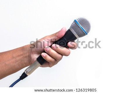 Man hand holding  microphone, isolated on white background - stock photo