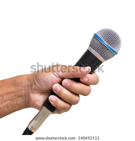 Man hand holding  microphone isolated on white background - stock photo