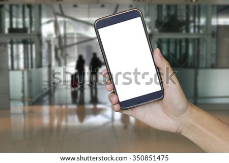 Man hand holding mobile smart phone , tablet,cellphone over Blur of office business stores background  - stock photo