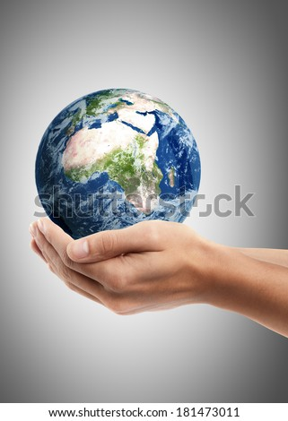 Man hand holding object ( Earth ) High resolution. including elements furnished by NASA  - stock photo