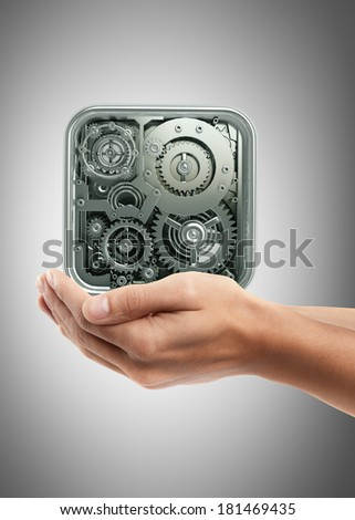 Man hand holding object ( gears box ) High resolution  - stock photo