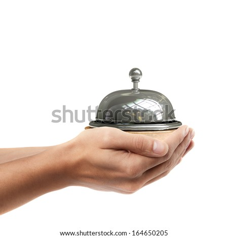 Man hand holding object ( Reception bell )  isolated on white background. High resolution  - stock photo
