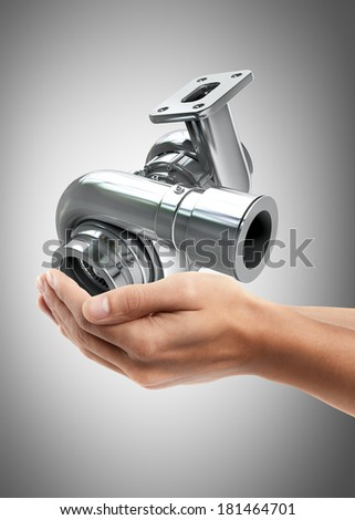 Man hand holding object ( Steel turbocharger ) High resolution