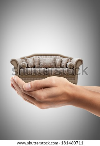 Man hand holding object ( vintage sofa )  High resolution  - stock photo