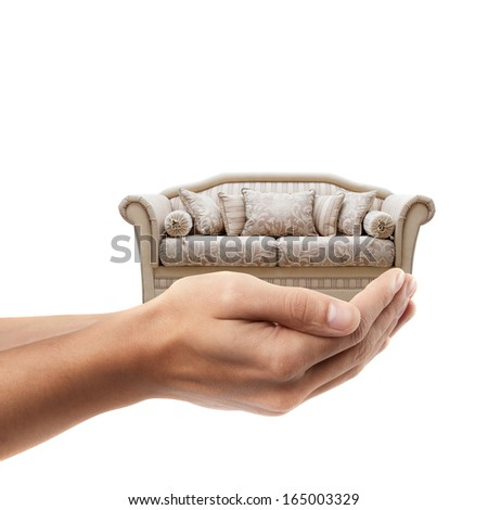 Man hand holding object ( vintage sofa ) isolated on white background. High resolution  - stock photo