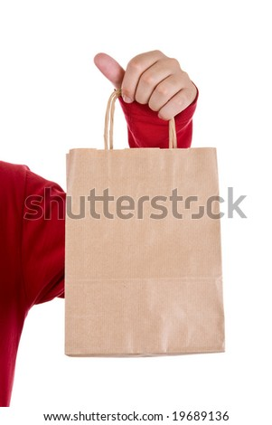 man hand holding paper bag isolated on white - stock photo