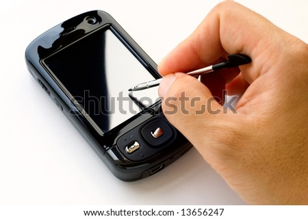 Man hand holding PDA and stylus, isolated over white - stock photo