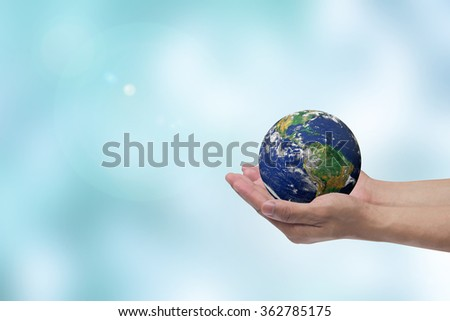 man hand holding planet on blur blue teal water surface background:human safe environmental:people and ecology efficiency idea:earth day 22 April concept:Elements of this image are furnished by NASA - stock photo