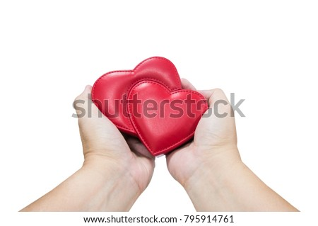 Man hand holding red leather heart isolated with clipping path, valentine couple love concept.