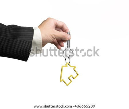 Man hand holding silver key with golden house shape keyring, isolated on white background. - stock photo