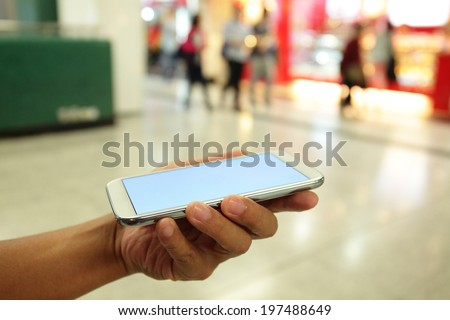 Man hand holding smart phone, great for your copy space - stock photo