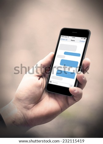 Man hand holding the smartphone with sms chat on a screen, iphon style - stock photo