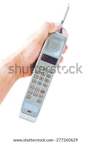 man hand holding vintage mobile phone Isolated on white background.