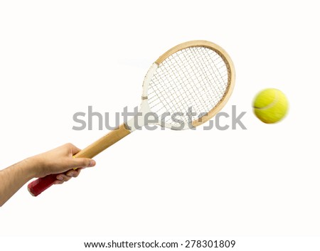 Man hand holding vintage racket over dark background and ball