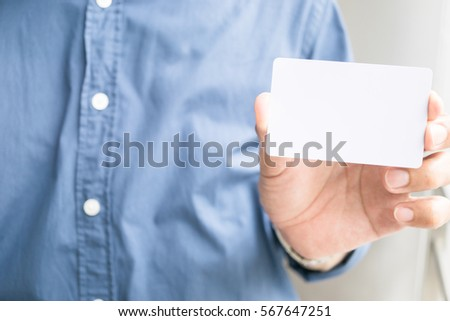 Man hand holding white card with copyspace for add text