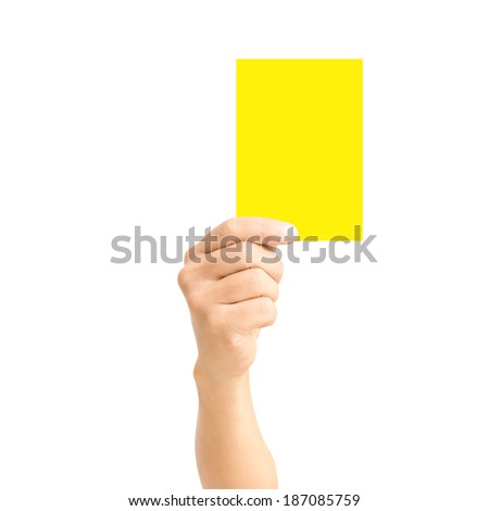 man hand holding yellow card isolated on white,for sport concept
