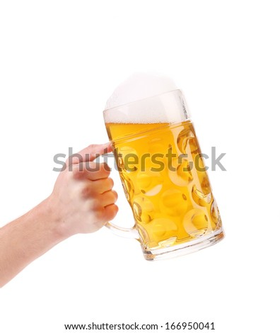 Man hand holds beer in mug. Isolated on a white background. - stock photo
