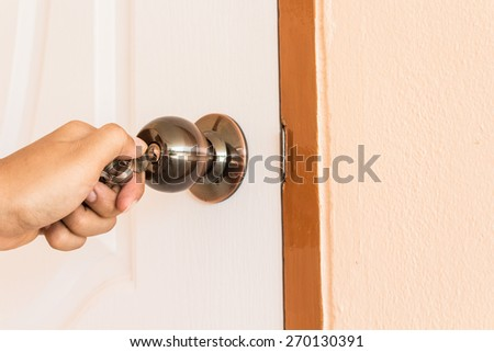 man hand Locking the Door - stock photo
