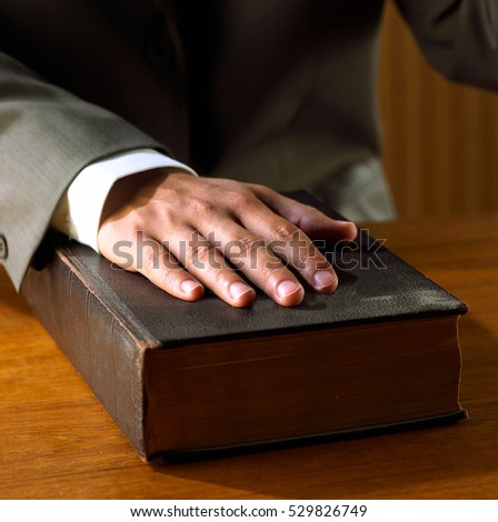 man hand on Bible book