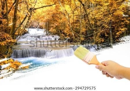 Man hand paint Waterfall  - stock photo