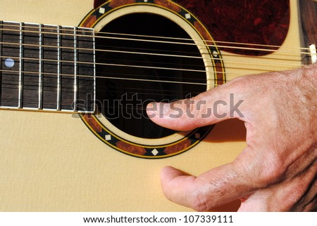 Man Hand Play An Acoustic Twelve Strings Guitar