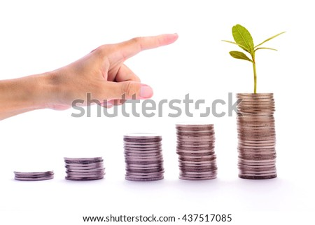 Man hand point to stack of graph money coins  growing up with sprout plant, business concept in money and growing business, closeup, side view. - stock photo