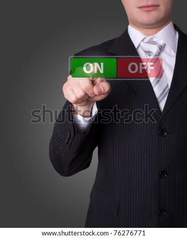 Man hand pressing ON / OFF button - stock photo
