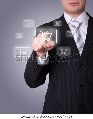 Man hand pressing shopping cart icon - stock photo