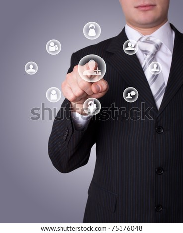 Man hand pressing social network button