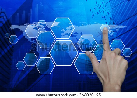 Man hand pushing blank modern virtual technology screen on map, graph and city tower, Elements of this image furnished by NASA - stock photo