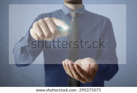 Man Hand pushing on touch screen interface  - stock photo