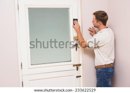 Man hand sanding the door before refinishing at home - stock photo