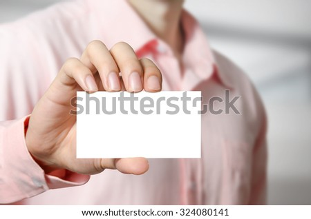 Man hand showing business white card.