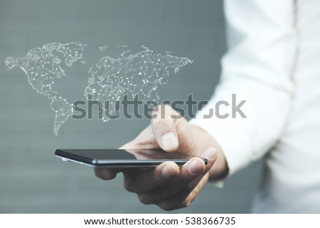 man hand smart phone and world map