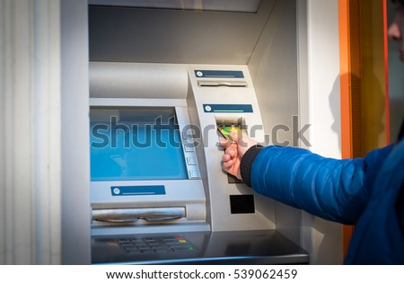 Man hand take credit card on atm