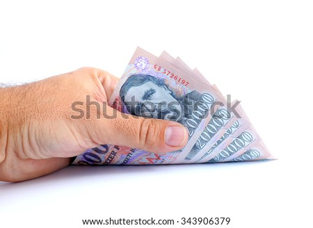 man hand taking up 20000 forint banknotes isolated on white