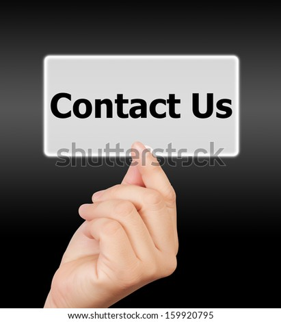 man hand touching button contact us keyword, on gray background.  - stock photo