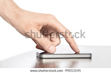 Man hand touching screen on modern mobile smart phone. Isolated white background. - stock photo