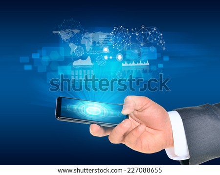Man hand using smart phone. World map and graphs near phone. Technology concept