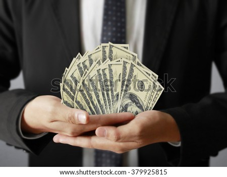 man hand with a dollars  - stock photo