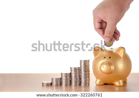 man hand with coins plan to saving money with gold piggy bank isolated on white background - stock photo