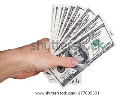 Man hand with 100 dollar bills isolated on a white background - stock photo
