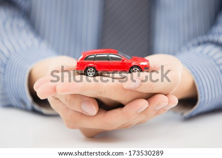 man hand with holding red car