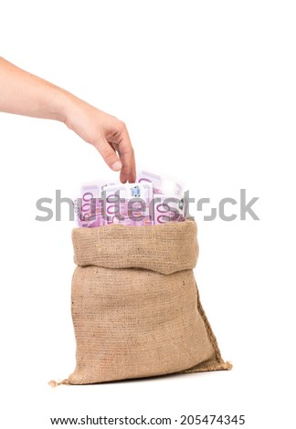 Man hand with money bag full with euro bills - stock photo