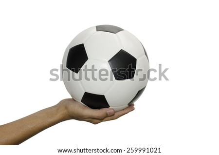 Man hand with new Black and white soccer ball isolated - stock photo