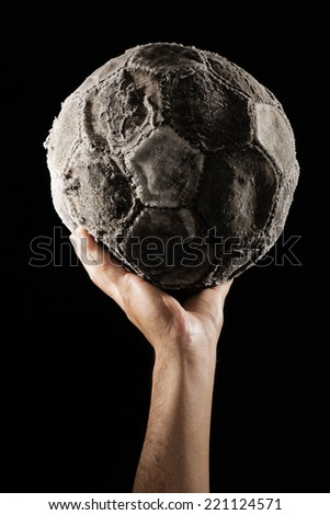 man hand with Old and vinatage soccer ball on white background. - stock photo