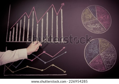 man hand with pen and business report - stock photo